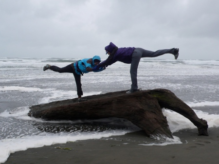 Grace and Jerry's miraculous Warrior III on driftwood with tide coming in (and strong winds!).