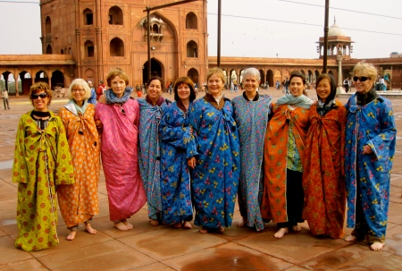 At the largest mosque in Old Delhi.  All the women in our group had to cover up in these flowery robes!