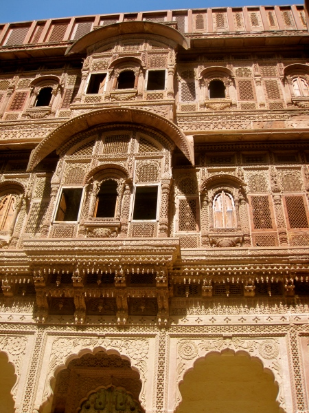 Palaces within the fort. The women watched the world behind stone screens, carved to look like lace