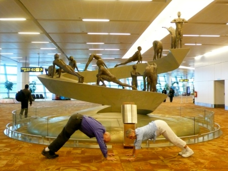 Woody and Ginger in Downward Facing Dog at the airport!!!