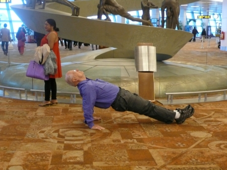 Woody in Reverse Plank in front of the sculpture at the airport on our way to Jodhpur!