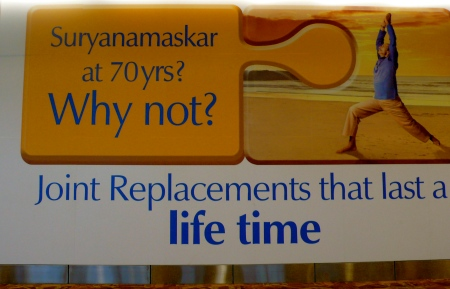 Advertisement near the SuryaNamaskar (Sun Salutation Sculptures)