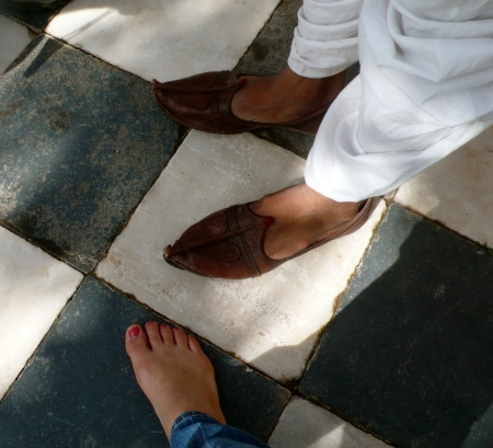 Got to have FEET in a photo!  (for Jack!)  The curly cue Rajasthani shoes of a man next to my bare feet before entering the Jaswant Thada (must remove shoes before entering the mausoleum)