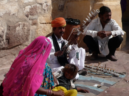 Musician and his family just inside of the fort.