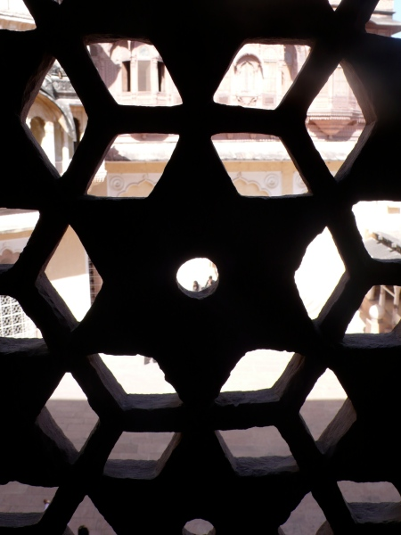 We went into the palaces and I was able to peep through the carved lattice-like stone and see the court below