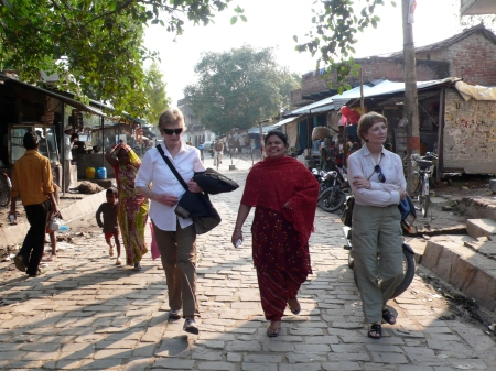Bobbie and Peggy walk through the clean village of Shivlineshwar with Renu.