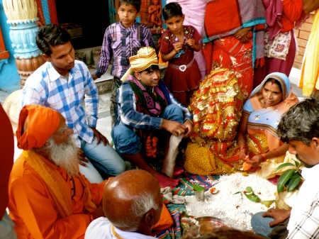 a wedding at the Shiva temple!  The bride's head is covered with a red gold-threaded veil
