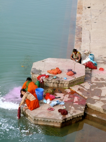 Varana River and ladies washing their clothing against the rocks.
