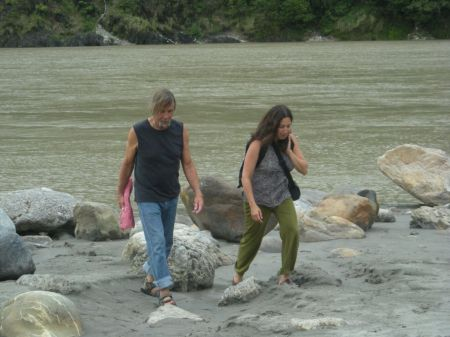 Don and Fran wading in the fast flowing Ganga (Rishikesh)