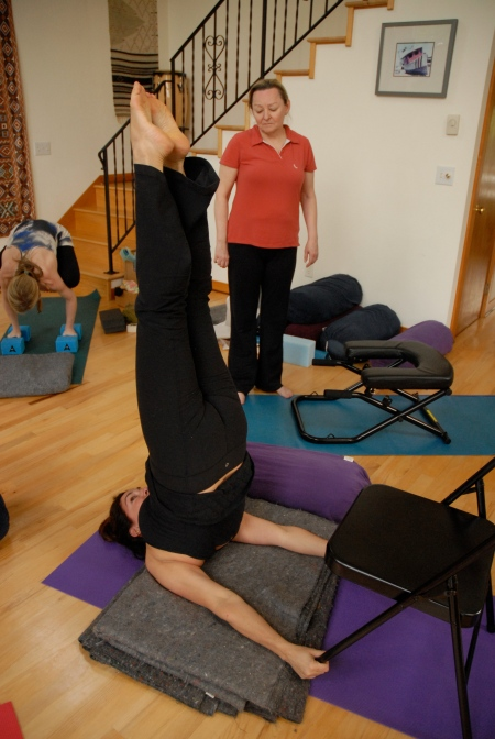 Fran demonstrates Shoulderstand using backless yoga chairs.