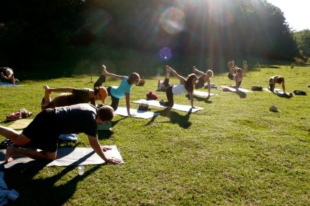 Yoga in the sun drenched meadow in the Apennines