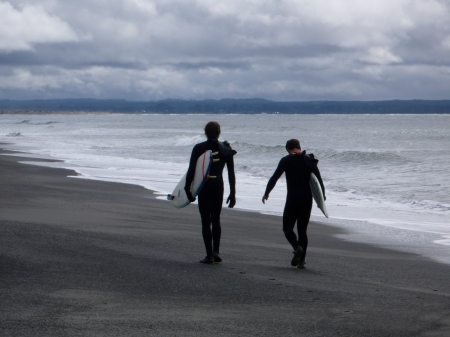 Surfers at the beach.