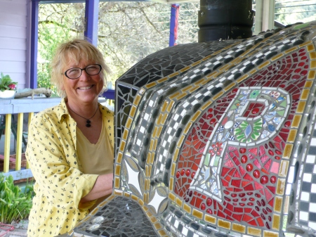 Karen Biondo with her beautiful pizza oven!  She and Leslie make and sell pizza at the Vashon Farmers' Market