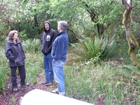 Susan, Peter, and Rick standing at the future site of The Lotus Pavilion, our Northwest Rain Forest Yoga Retreat Sanctuary Studio.