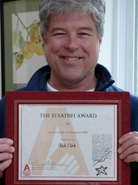 Rick holding his Starfish Award for 2012 Outstanding Volunteerism!