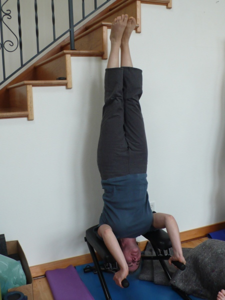 Laura does a headstand on the headstand bench