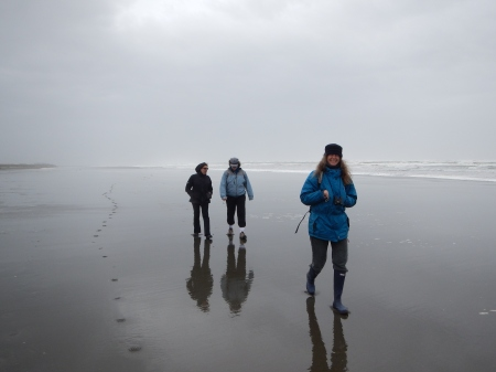 Walking on reflective sand, Ocean Shores, WA